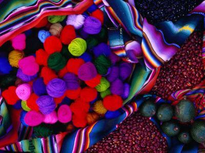 Yarn and Red Nuts in Market Stall, Chichicastenango, Guatemala by Jeffrey Becom