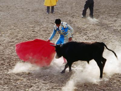 Young Bullfighter Performing in Bullring During Festival of the Holy Cross, Yanque, Arequipa, Peru