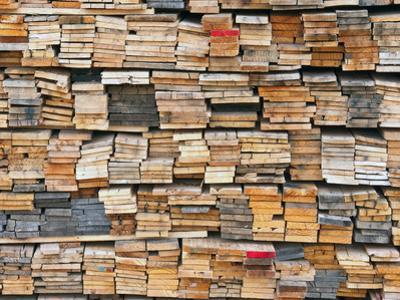 Stacked Boards at Recycling Business, Michigan, USA by Jeffrey Wickett