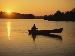 Georgia, Canoe on a Lake at Sunrise by Jennifer Broadus