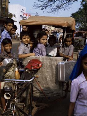 Schoolchildren in Cycle Rickshaw, Aleppey, Kerala State, India by Jenny Pate