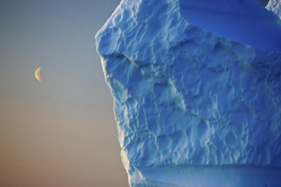 Edge of Iceberg with the Moon in the Sky, Greenland, August 2009