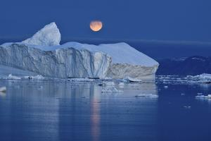 Full Moon over an Iceberg at Dusk, Saqqaq, Disko Bay, Greenland, September 2009 by Jensen