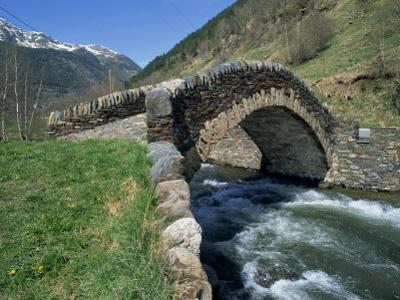 Ancient Stone Bridge over a River in the La Malana District in the Pyrenees in Andorra, Europe