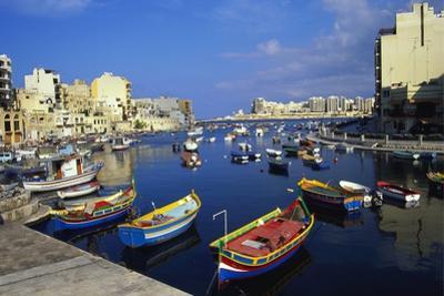 Boats Moored in Saint Julians Bay, Malta by Jeremy Lightfoot