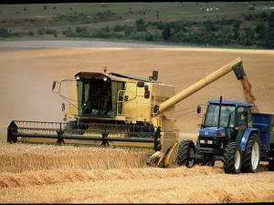 Combine Harvester Off-loading Grain by Jeremy Walker