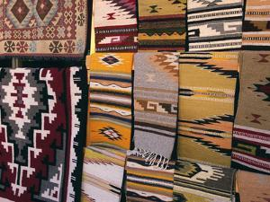 Hand woven blankets made by Native Americans for sale in Old Town Albuquerque, NM. by Jerry Ginsberg