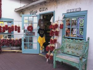 Traditional Ristras in Old Town Albuquerque, New Mexico, USA by Jerry Ginsberg