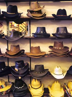 Wide variety of cowboy hats in Old Town Albuquerque, NM. by Jerry Ginsberg