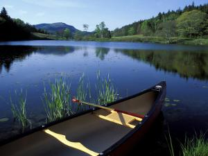 Canoe Resting on the Shore of Little Long Pond, Acadia National Park, Maine, USA by Jerry & Marcy Monkman