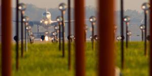 Jet airplane taking off from Detroit Metro Airport, Romulus, Michigan, USA