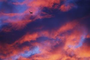 Jet Among Clouds at Sunset