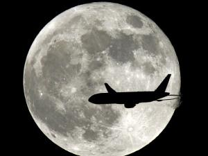 Jet Plane Passes in Front of the Full Moon Above Surfside, Florida