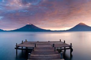 Jetty in a lake with a mountain range in the background, Lake Atitlan, Santa Cruz La Laguna, Wes...