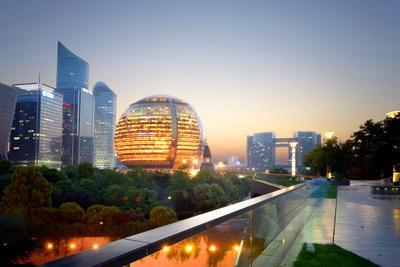 https://imgc.allpostersimages.com/img/posters/jianggan-district-continues-to-fascinate-with-modern-skyscrapers-and-sphere-shaped-architecture_u-L-PWFEBV0.jpg?p=0