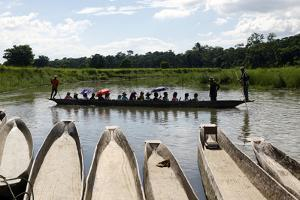 A Popular Activity in Chitwan National Park Is Getting a Ride in a Traditional Dugout Canoe by Jill Schneider