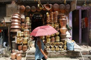 A Woman Walks Through the Jamel Marketplace by Jill Schneider