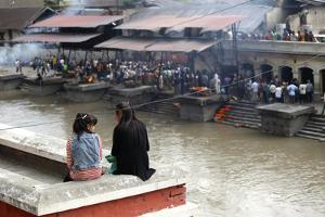 Girls Watch Hindu Cremations at Pashupatinath Temple by Jill Schneider