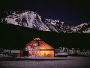 A Warm Glow Comes from the Dutchers Tent at Night by Jim And Jamie Dutcher