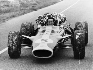 Jim Clark in a Lotus with the Winner's Laurel Wreath