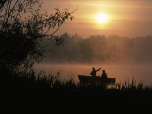 Fishermen in Small Boat, Lake Cassidy, WA by Jim Corwin