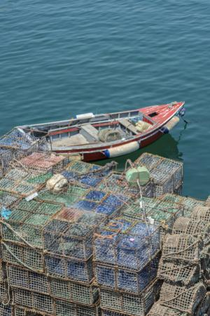 Portugal, Cascais, Lobster Traps and Fishing Boat in Harbor