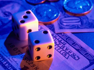 Dice and Money on Blue Background by Jim McGuire