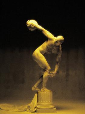 Nude Man Painted Gold Posing As a Statue by Jim McGuire