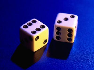 Two Dice on Blue Background by Jim McGuire