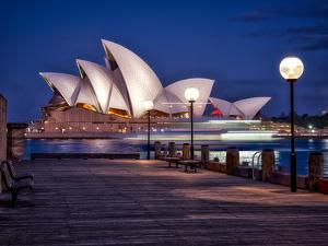 A Boat Passes by the Sydney Opera House, UNESCO World Heritage Site, During Blue Hour by Jim Nix