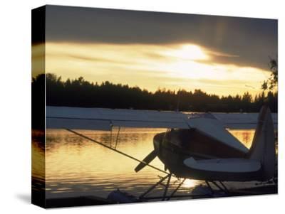 Backlit Floatplane, AK by Jim Oltersdorf