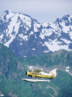 Seaplane in Flight Near Mountains, AK by Jim Oltersdorf