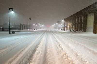 A Snowstorm Strikes a City in the Middle of the Night