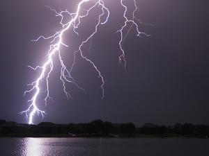 Lightning Striking Ground Near Residential Lake by Jim Reed