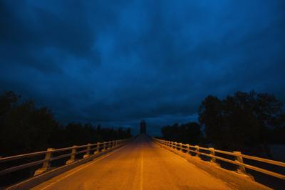 Stormy Sky over Bridge at Night by Jim Reed