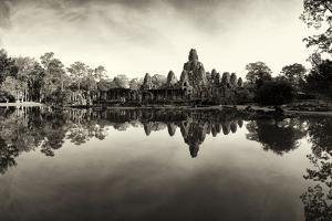 Bayon Temple and Lush Flora Cast a Mirror Reflection on Water by Jim Ricardson