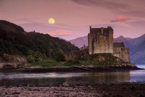 Eilean Donan Castle and Its Reflection on a Sea Loch Under Moonrise by Jim Ricardson