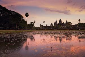 Sunrise Colors Reflect on a Lily Pad Filled Lake Fronting Angkor Wat by Jim Ricardson