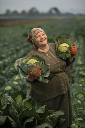 A Cabbage Farmer on Her Farm