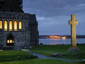 A Celtic Cross Stands Outside the Iona Monastery Church at Dusk by Jim Richardson
