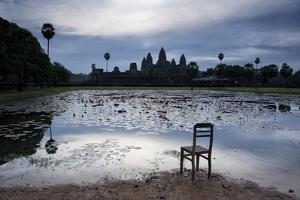 A Chair on the Shoreline of the Lake Fronting Angkor Wat by Jim Richardson