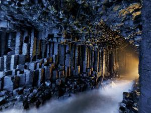 Basalt pillars line Fingal's Cave. by Jim Richardson