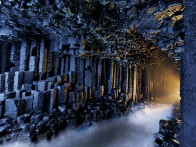 Basalt pillars line Fingal's Cave. by Jim Richardson