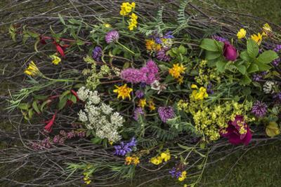 Flowers from a pagan wedding at a Neolithic henge monument with a stone circle. by Jim Richardson