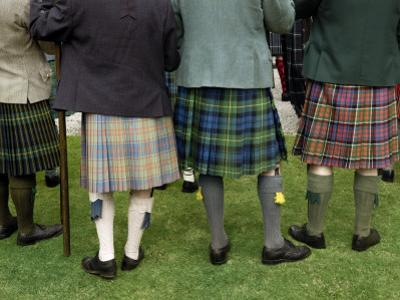 Highlanders in Kilts at the Lonach Gathering by Jim Richardson
