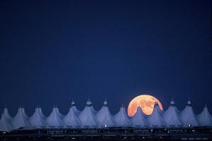 Moonrise over Denver International Airport by Jim Richardson