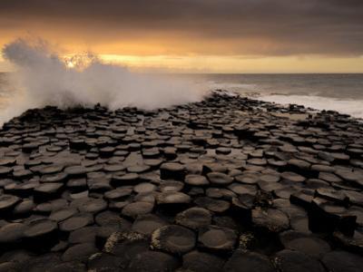 Surf Crashes onto the  Giant's Causeway Rocks by Jim Richardson