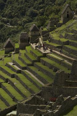 Tourists Explore the Terraced Pre-Columbian Inca Ruins of Machu Picchu by Jim Richardson