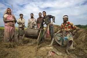 Villagers of Jaghati Threshing Rice by Jim Richardson