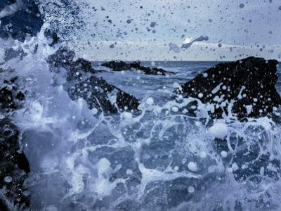 Waves Crash on the Shore in a Close-up View of the Ocean by Jim Richardson